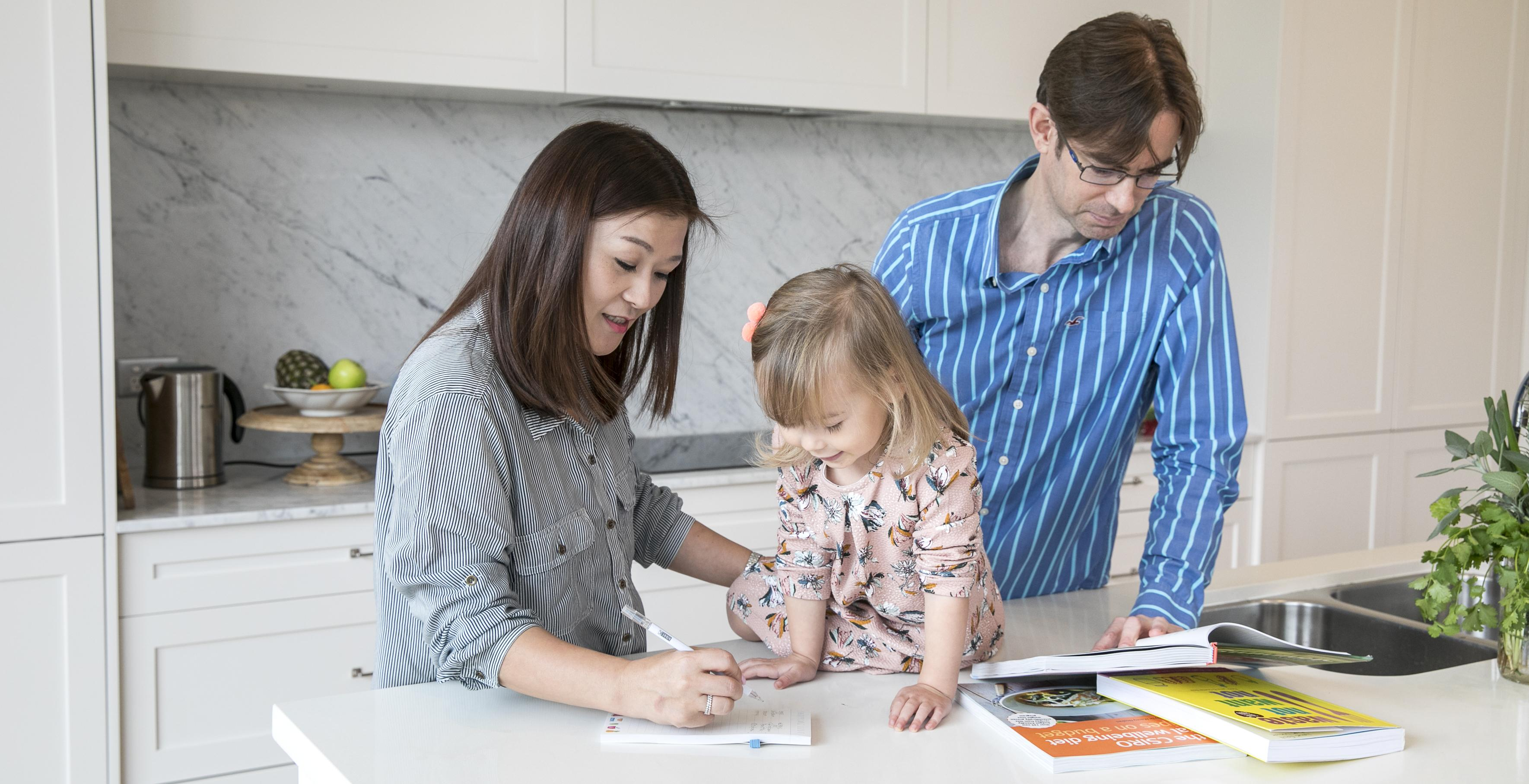 Family with child writing a meal plan